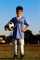 Soccer Player Carrying Ball