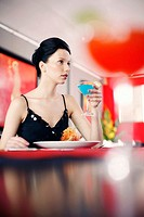 Woman eating in a restaurant (thumbnail)