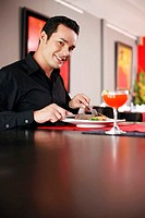 Man enjoying his meal in a restaurant