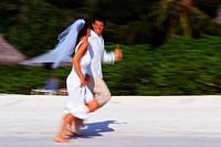 Newlyweds Running on Beach