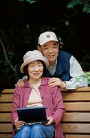 Park bank, senior couple, Asians,  smiling, laptop,   couple, seniors, Asian, 60-70 years, headgears, cheerfully, happily, touch, leisure time, outsid...
