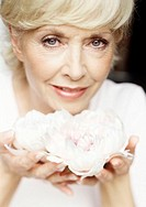 Sofa, woman, middle age, palms, Blooms, portrait, truncated,   Series, 50-60 years, blond, gaze camera, smiling,  Hands, flowers, peonies, holding, sh...
