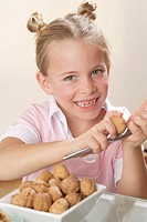 Girls, peel, nuts, nutcrackers,  Walnut, opens,   Series, 6 years, child, blond, gaze camera, naturalness, laughing, eat candy cheerfully, walnuts, ea...