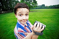 Boy holding a camcorder