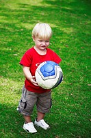 Little boy holding a ball