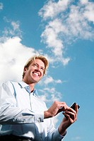 Businessman using a handheld device
