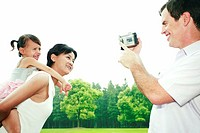 Man recording images of his wife and daughter