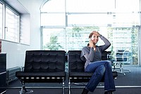 Office, leather chairs, businesswoman,  telephones, gesture, relief,   sitting series, woman, 20-30 years, employees, chairs, bench, cell phone teleco...