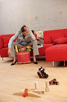 Woman, young, shopping bag, couch,  sitting, wearily, exhausted, floor,  Toy,  Series, 20-30 years, parent, single, at home, working, purchases, unfor...