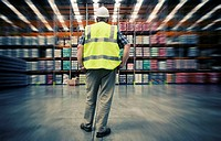 Man looking at warehouse goods