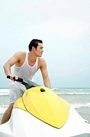 Man riding on jet ski