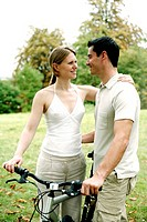 Couple and a bicycle in the park (thumbnail)