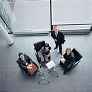 Four business people in office building (thumbnail)