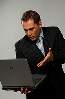 Businessman looking at his laptop in disbelief (thumbnail)
