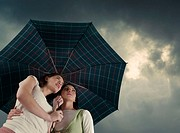 Two women under an umbrella