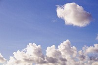 Puffy white clouds in blue sky