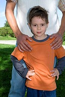 Father with hand on son's (4-7) shoulder, portrait, close-up