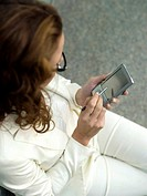 Businesswoman using palmtop, elevated view, close-up
