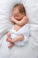 Baby in diaper sleeping, elevated view