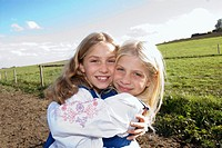 Two girls embracing, portrait