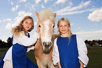 Two girls with pony