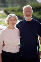 Portrait of active smiling senior couple in an outdoor park