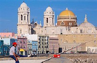 Spain, Andalusia, Cadiz, a fisherman on the Campo del Sur (cathedral in the background)