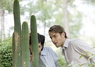 Couple looking at cactus