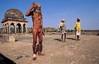 India, Madhya Pradesh, Mandu, sadhu on a palace terrace