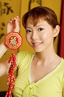 Woman holding Chinese door ornament