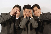 Three businessmen, covering eyes, mouth and ears