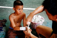 a young Thai boy before his first Thai - boxing lession