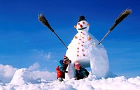France, Savoie (73), Valmorel ski resort, children palying in snow (Model Release OK)