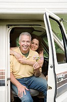 Mature couple hugging in caravan