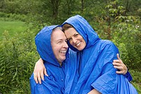 Mature couple wearing raincoats (thumbnail)