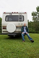 Mature man with caravan