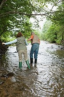 Mature couple walking in stream