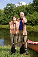Mature couple leaning on oars