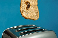 Toast with heart shape burn and toaster