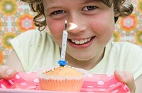 Girl with birthday cupcake (thumbnail)