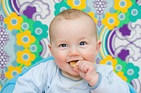 Baby eating a biscuit (thumbnail)