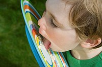 Boy licking food off plate