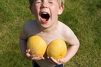 Boy holding melon halves