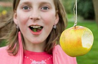 Girl and apple on a string