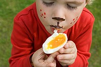 Boy eating an egg