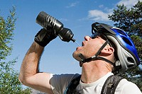 Mountain biker drinking from bottle
