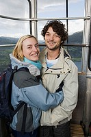 Smiling couple in a cable car