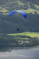 Person parachuting near a mountain