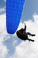 Person with a blue parachute