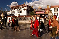 Monks and tourist in front of the Jhokang temple, Lhasa, Tibet